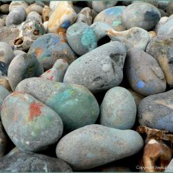 Paint on pebbles at the beach