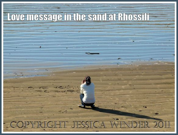 "Romantic Rhossili: ""I love you forever"" - a young woman writing a love message in the sand at Rhossili Bay, Gower, South Wales, 18 March 2011 (3)"