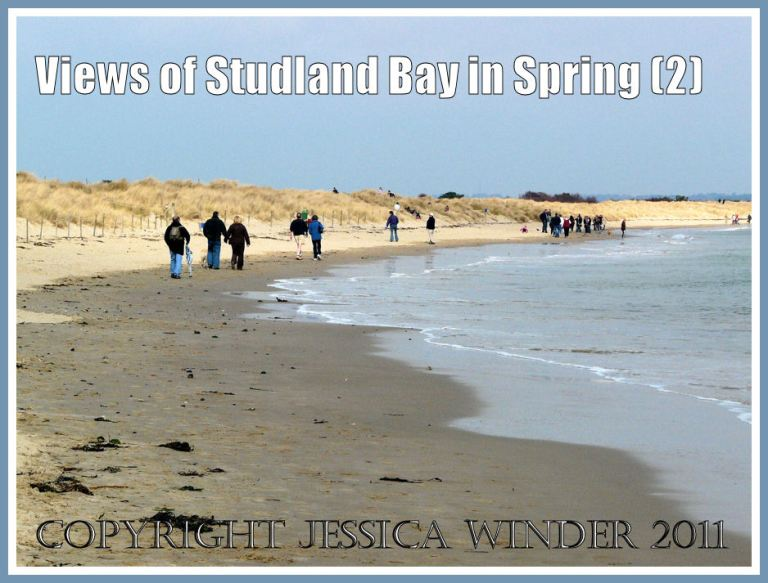 Studland Beach photograph: People walking along the narrow strip of beach at high tide in March at Studland Bay, Dorset, UK - part of the Jurassic Coast (P1050389aBlog2)