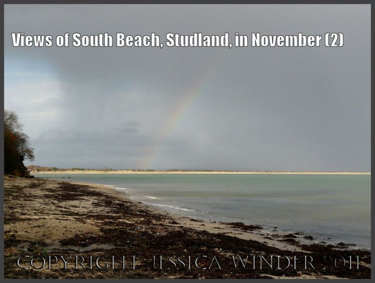 Studland Bay view: View from South Beach of a rainbow's end illuminating the long sandy strip of Knoll Beach, Studland Bay, Dorset, UK - part of the Jurassic Coast 27th November 2009 (2)