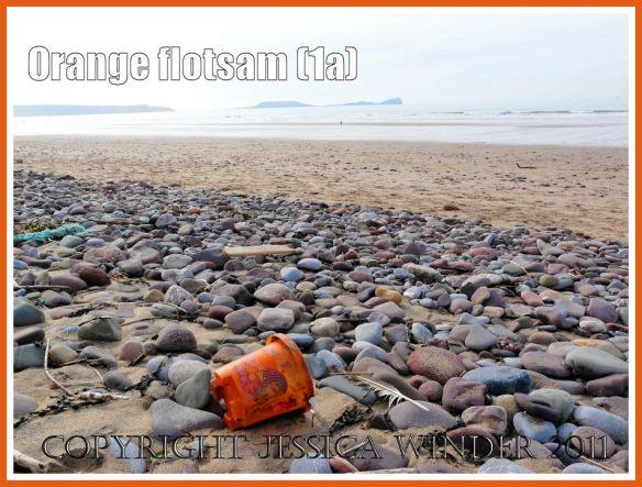 Orange flotsam: A child's orange plastic seaside bucket on the beach as flotsam (1a)