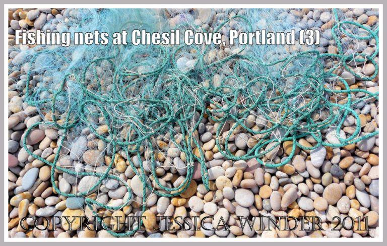 Fishing nets on beach pebbles: Fishing nets on the pebble beach at Chesil Cove, Portland, Dorset, UK - part of the Jurassic Coast (3)