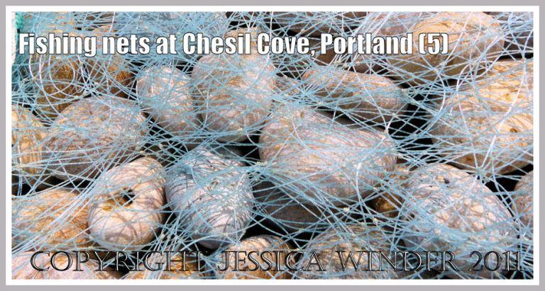 Blue fishing nets drying on flint and chert pebbles at Chesil Cove, Portland, Dorset, UK - part of the Jurassic Coast (5)