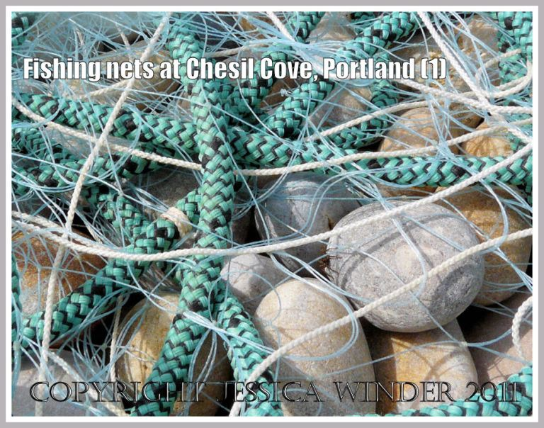 Fishing nets drying on the beach: Fishing nets and ropes on the pebble beach at Chesil Cove, Portland, Dorset, UK - part of the Jurassic Coast (1)