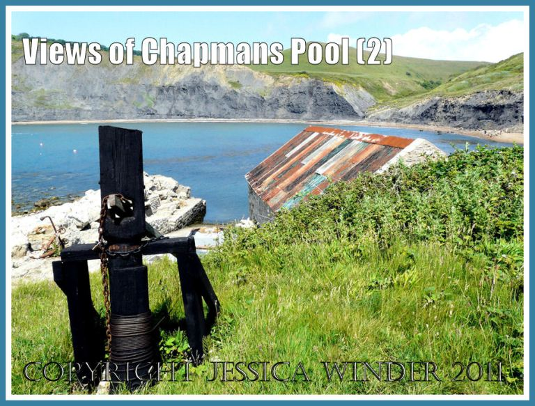 View of Chapmans Pool, Dorset, UK, on the Jurassic Coast World Heritage Site, with old wooden boat winch and fisherman's hut in the foreground (2)
