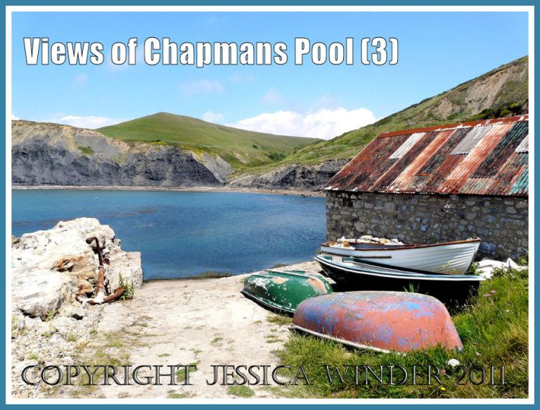 View of Chapmans Pool, Dorset, UK, on the Jurassic Coast World Heritage Site, with small boats and fisherman's hut in the foreground (3)