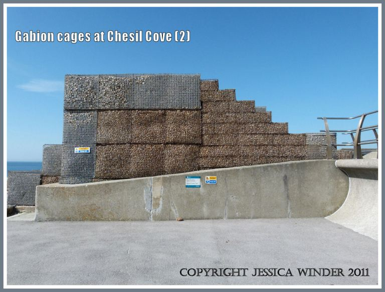 Gabions on the sea wall at Chesil Cove: Stacked gabion cages filled with pebbles on top of the sea wall - supplementing the sea defences at Chesil Cove, Isle of Portland, Dorset, U.K. on the Jurassic Coast (2)