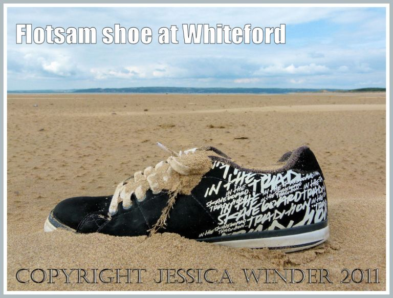 Flotsam trainer shoe with writing on the beach at Whiteford Sands, Gower, South Wales, UK (3)