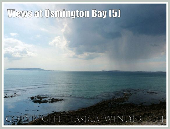 View of a cloud burst over Weymouth from the cliff top at Osmington Bay, Dorset, UK, part of the Jurassic Coast (5)