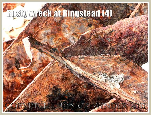 Texture of rusty iron: Detail from a rusty iron ship wreck at Ringstead Bay, Dorset, UK - part of the Jurassic Coast (4)