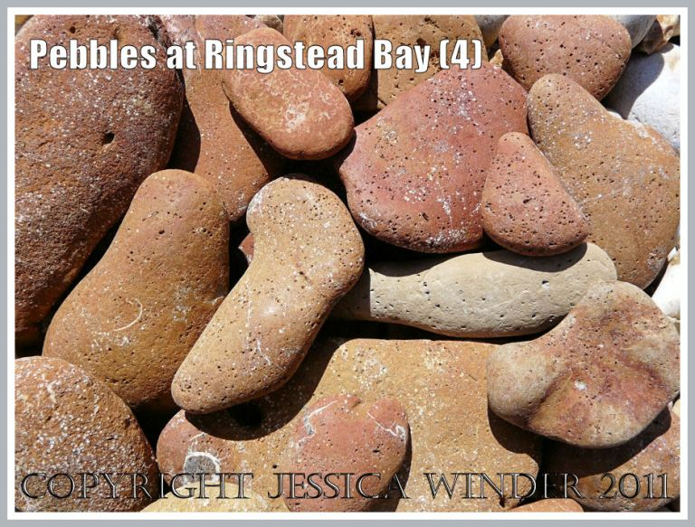 Dorset beach pebbles: Close-up of a selection of rusty brown pebbles on the shingle beach at Ringstead, Dorset, UK - part of the Jurassic Coast (4)