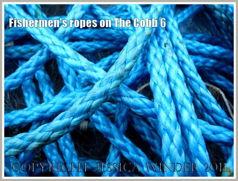 New blue shiny fisherman's rope in a tangle  on the quay of the Cobb at Lyme Regis, Dorset, UK (6)
