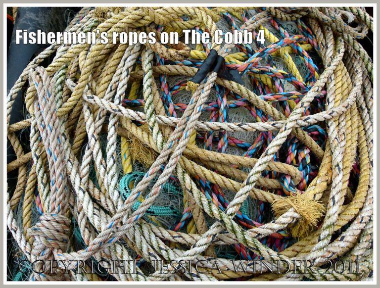Fishing ropes on the quayside: Tangled heap of old ropes from fishing boats on the quay of the Cobb at Lyme Regis, Dorset, UK (4)