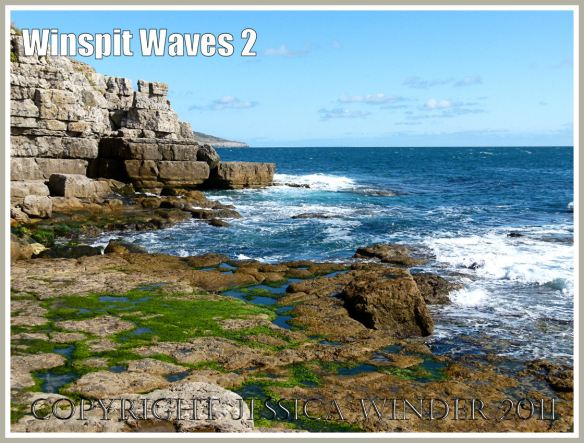 The waves breaking on the man-made rock ledge at Winspit, Dorset, UK on the Jurassic Coast.
