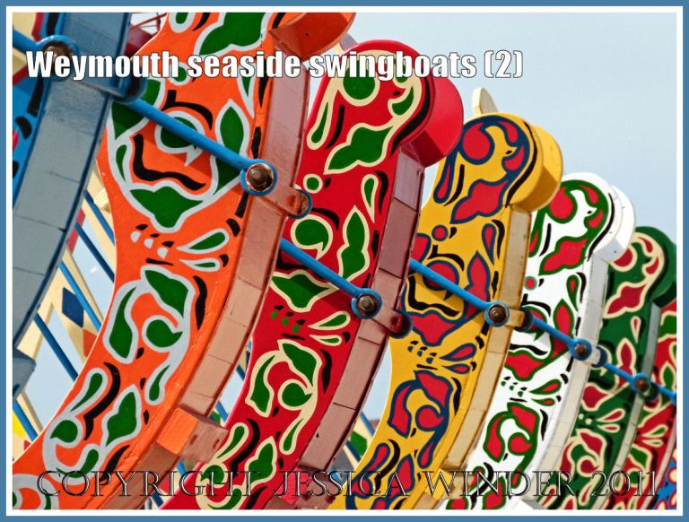 Brightly painted swingboats on the golden sands at Weymouth, Dorset, UK (2)