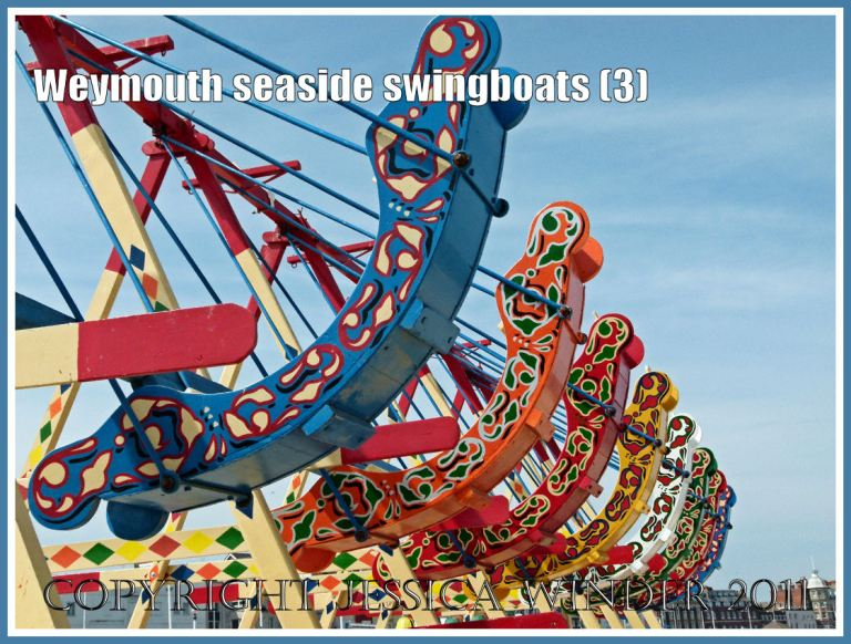 Brightly painted swingboats on the golden sands at Weymouth, Dorset, UK (3)
