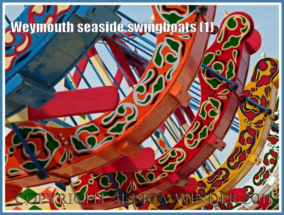 Brightly painted swingboats on the golden sands at Weymouth, Dorset, UK (1)