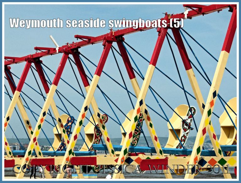 Brightly painted swingboats on the golden sands at Weymouth, Dorset, UK (5)