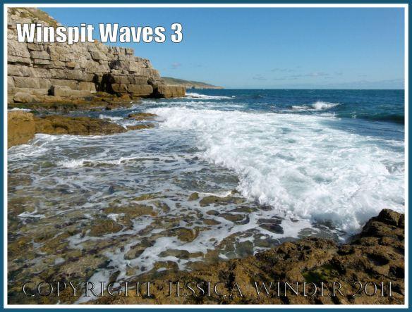 Waves breaking on the rock ledge at Winspit, Dorset, UK, on the Jurassic Coast