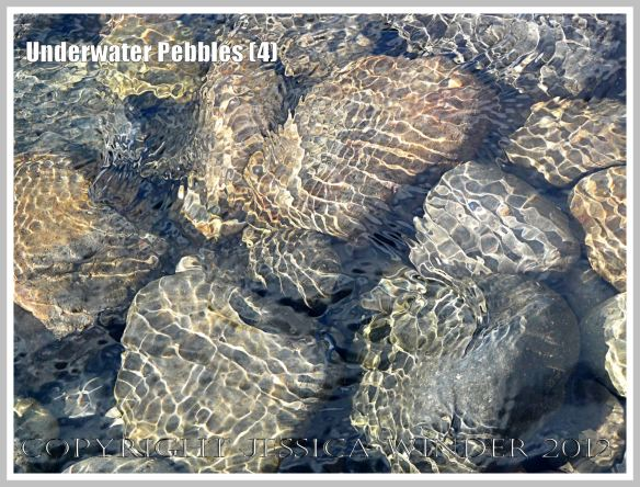 Underwater Pebbles (4) - Pebbles viewed through shallow river water with patterns of reflected sunlight from the water ripples, photographed on the beach in Neptune State Park, south of Yachats, Oregon, U.S.A.