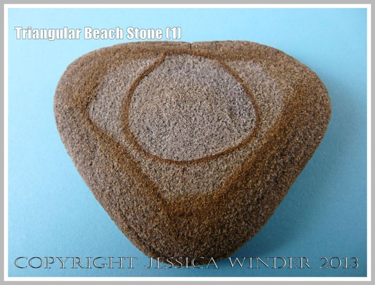Triangular Beach Stone (1) - Natural triangular shape of a pebble or beach stone with a natural geometrical pattern.