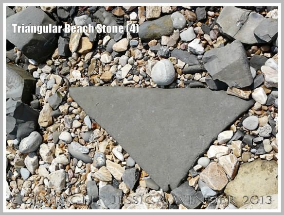 Triangular Beach Stone (4) - Natural triangular shape of a pebble or beach stone.