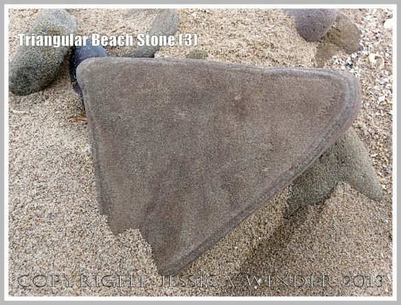 Triangular Beach Stone (3) - Natural triangular shape of a pebble or beach stone.