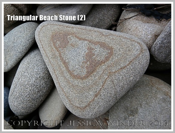 Triangular Beach Stone (2) - Natural triangular shape of a pebble or beach stone with a natural geometrical pattern.