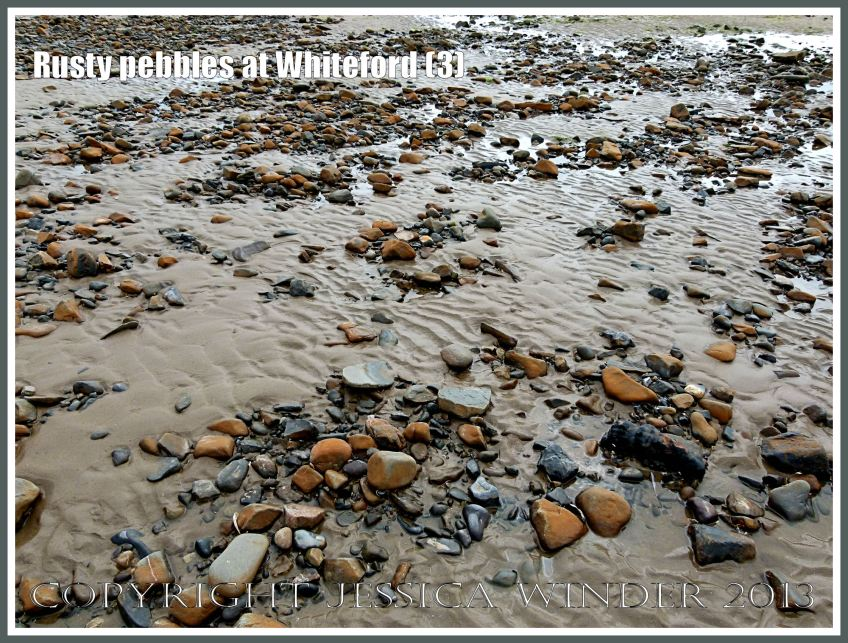 Rusty Pebbles at Whiteford (3) - Pebbles on the beach at Whiteford Sands, Gower, South Wales, some of which are covered with a rusty deposit thought to derive from the break up of an iron-pan associated with a Holocene peat layer.