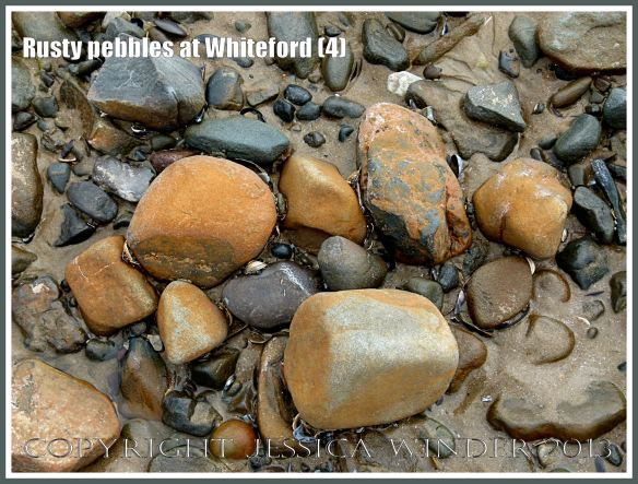 Rusty Pebbles at Whiteford (4) - Pebbles on the beach at Whiteford Sands, Gower, South Wales, some of which are covered with a rusty deposit thought to derive from the break up of an iron-pan associated with a Holocene peat layer.