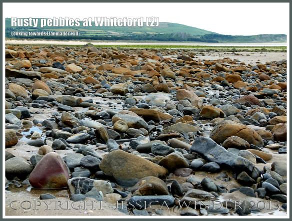 Rusty Pebbles at Whiteford (2) - View looking across to Llanmadoc Hill showing pebbles on the beach at Whiteford Sands, Gower, South Wales, some of which are covered with a rusty deposit thought to derive from the break up of an iron-pan associated with a Holocene peat layer.