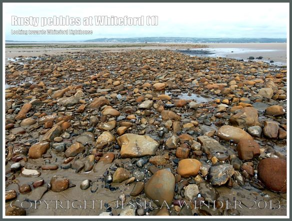 Rusty Pebbles at Whiteford (1) - View looking across to Llanmadoc Hill showing pebbles on the beach at Whiteford Sands, Gower, South Wales, some of which are covered with a rusty deposit thought to derive from the break up of an iron-pan associated with a Holocene peat layer.