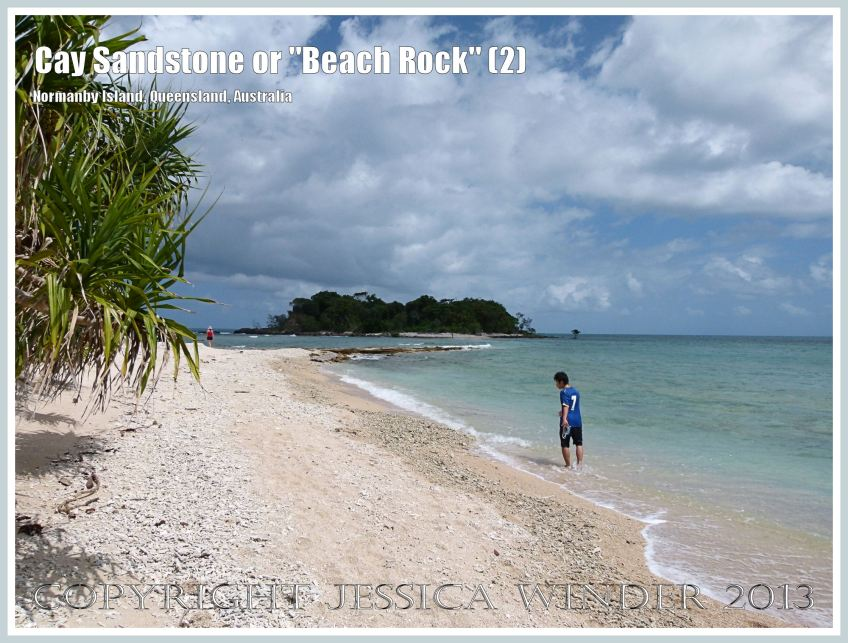 """Cay Sandstone or """"Beach Rock"""" (2) - Normanby Island is linked to an adjacent small island in the Frankland group by layers of """"Beach Rock"""" or Cay Sandstone recently formed by a natural cementation of coral and shell fragments in still shallow water in Queensland, Australia."""