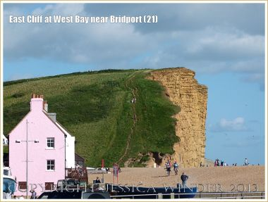 East Cliff at West Bay near Bridport (21) - View of East Cliff from the west. Approximately 43 metres depth of Bridport Sand Formation in the cliff was originally deposited at the rate of 1 metre every 20,000 years - taking about 860,000 years to accumulate in the Uper Lias phase of the Jurassic Period.