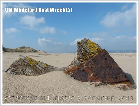 Remains of a small boat wreck in the sand