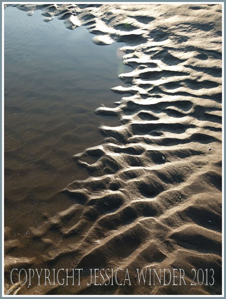 Sand ripple pattern at the dge of a tide pool