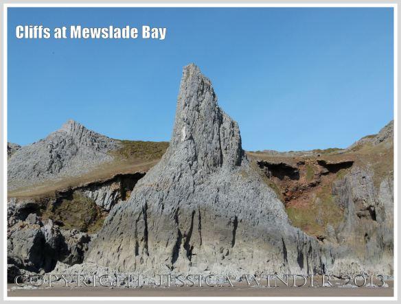 Limestone cliff peak with raised beach behind it.