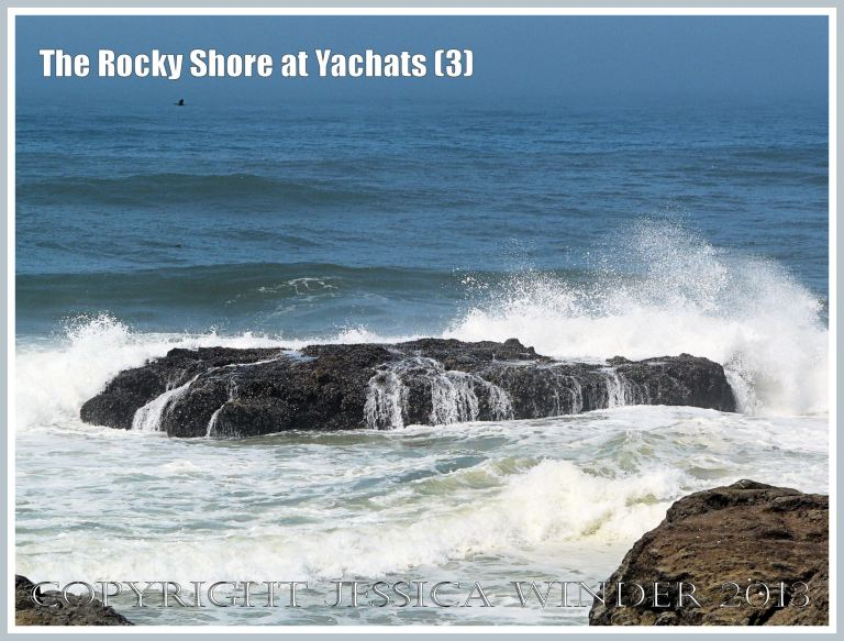 Waves crashing over rocky outcrop at Yachats