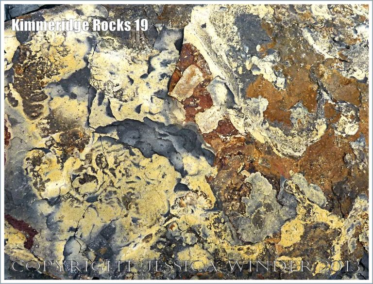 Iron and sulphur compound deposits on broken shale