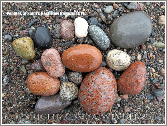 Natural patterns and colours in pebbles of mostly igneous rocks like granite on the shore at Saints Rest Beach, Irving Nature Park, New Brunswick, Canada.
