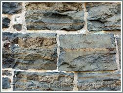 A wall of local meta-sedimentary rocks in one of the Historic Properties on the Halifax waterfront, Nova Scotia, Canada.