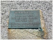Warning sign on the glaciated granite landscape at Peggy's Cove, Nova Scotia, Canada