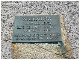 Warning sign on the glaciated granite landscape at Peggy's Cove, Nova Scotia, Canada