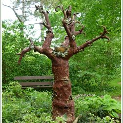 "Sculpture ""Treeology"" by Marla Benton, Teresa Bergen and Mary Jane Lundy at Historic Gardens, Annapolis Royal, Nova Scotia, Canada."