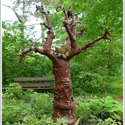 "Sculpture ""Treeology"" by Marla Benton, Teresa Bergen and Mary Jane Lundy at Historic Gardens, Annapolis Royal, Nova Scotia, Canada."