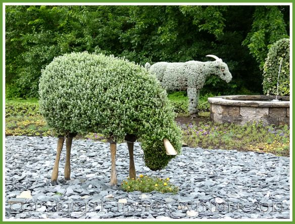 Mosaiculture sheep and goat - part of a mosaiculture tableau depicting the shepherd who changed a desolate and arid land into fertile fields and forest by planting trees.