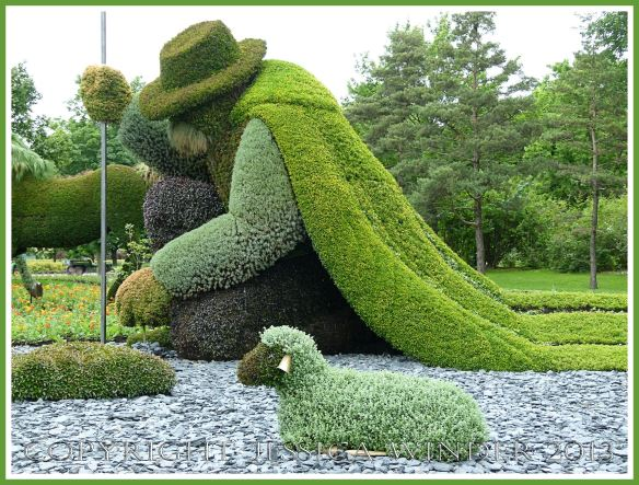 Mosaiculture shepherd - part of a mosaiculture tableau depicting the shepherd who changed a desolate and arid land into fertile fields and forest by planting trees.