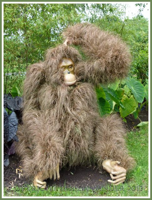 "Orangutan mosaiculture sculpture, entitled ""Hands Up"", made with living plants."