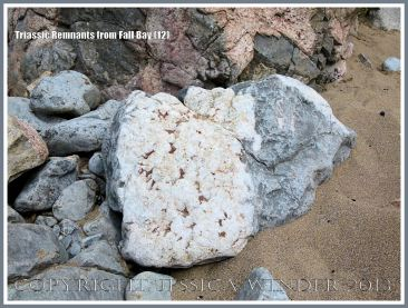 Red Triassic rock remnant with calcite crystal in faulted Carboniferous limestone.