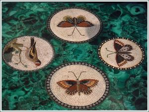 Early 19th century micromosaic pictures of butterflies set on a green malachite block
